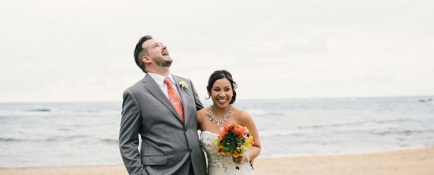 Happy bride and groom at a Hawaii destination wedding wedding planner Mango Muse Events Passport to Joy