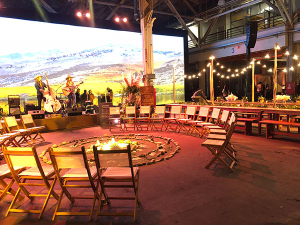 Country band playing at a bridal show for a rustic outdoor glamping wedding by Destination wedding planner Mango Muse Events creator of Passport to Joy