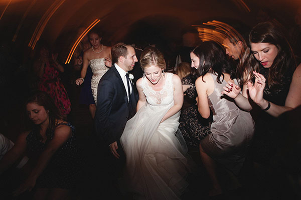 Bride, groom and guests dancing the night away at a Sonoma wedding reception by Destination wedding planner Mango Muse Events creator of Passport to Joy