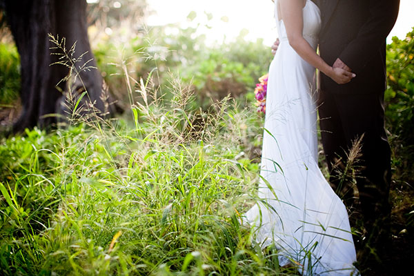 Bride and groom taking a moment alone at their wedding in Maui by Destination wedding planner Mango Muse Events creator of Passport to Joy