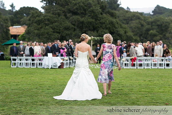 Bride and mother of the bride walking down the aisle at a Carmel wedding ceremony by Destination wedding planner Mango Muse Events creator of Passport to Joy