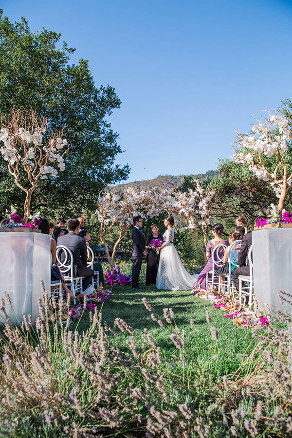 Modern elegant natural wine country wedding ceremony at Calistoga Ranch by Destination wedding planner, Mango Muse Events creator of Passport to Joy