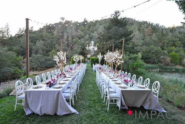 Dinner lawn string lights and chandeliers by Impact SF for a Calistoga Ranch wedding by Destination wedding planner Mango Muse Events creator of Passport to Joy
