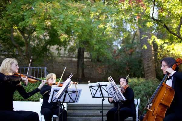 Ceremony string quartet playing at a wine country wedding by Destination wedding planner Mango Muse Events creator of Passport to Joy