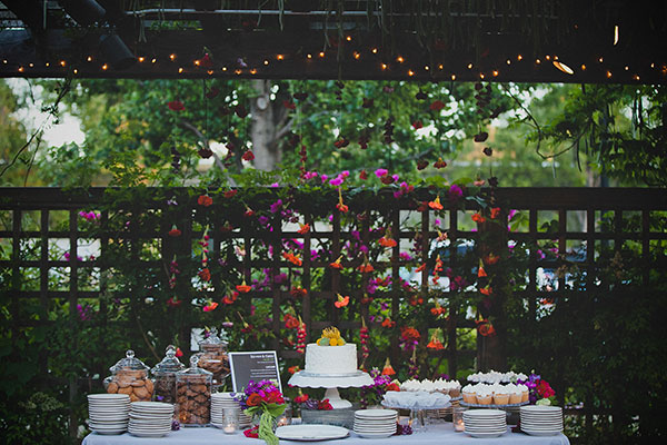 Colorful wedding dessert bar with sweet treats at a wedding at the Los Altos History Museum designed by destination wedding planner, Mango Muse Events creator of Passport to Joy