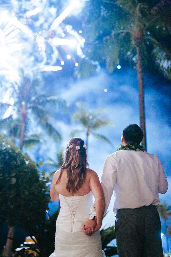 Bride and groom enjoying the fireworks New Years Eve wedding inspiration by Destination wedding planner, Mango Muse Events creator of Passport to Joy