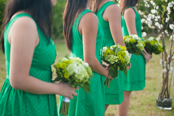 Bridesmaids with kelly green dresses and green bouquets at wedding in Hawaii by Destination wedding planner Mango Muse Events creator of Passport to Joy