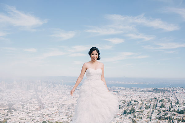 A happy bride at her San Francisco wedding with a view by Destination wedding planner Mango Muse Events creator of Passport to Joy