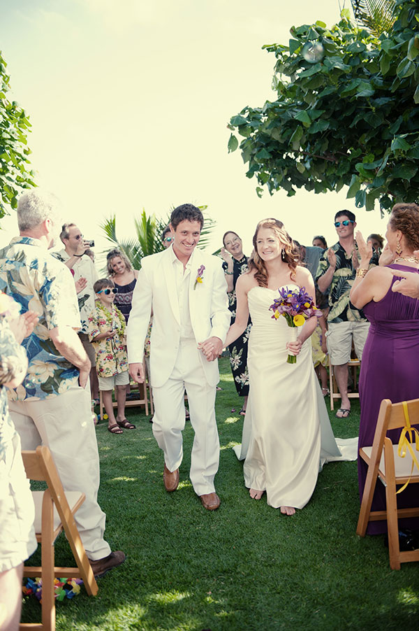 Bride and groom at their intimate wedding ceremony in Hawaii planned by Destination wedding planner, Mango Muse Events creator of Passport to Joy