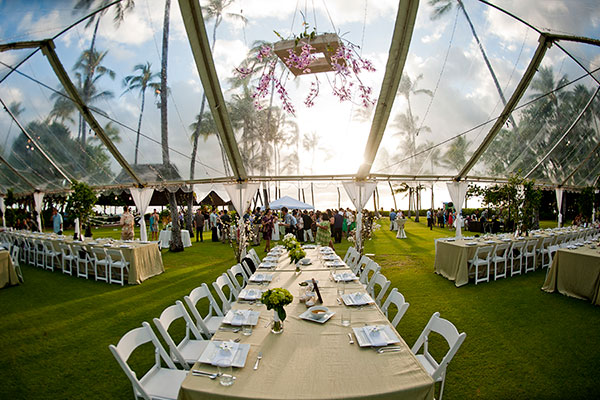 Clear wedding tent at a Hawaii wedding at Lanikuhonua private estate in Hawaii by Destination wedding planner Mango Muse Events creator of Passport to Joy
