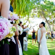 An outdoor wedding ceremony in Hawaii at Lanikuhonua private estate by Destination wedding planner, Mango Muse Events creator of Passport to Joy
