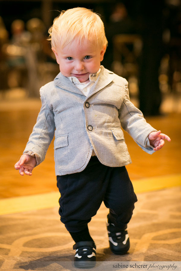 Cute kid on the dance floor at a Carmel wedding reception by Destination wedding planner Mango Muse Events creator of Passport to Joy