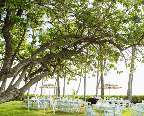 Outdoor wedding at the private estate Lanikuhonua in Hawaii by Destination wedding planner Mango Muse Events creator of Passport to Joy