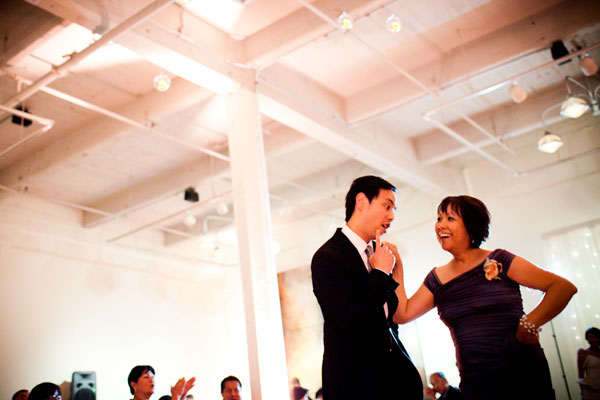 Groom and mother of the groom dancing the mother son dance at a wedding reception in San Francisco at Terra by Destination wedding planner Mango Muse Events creator of Passport to Joy