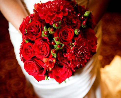 Red bridal wedding bouquet Valentine's day wedding inspiration by destination wedding planner Mango Muse Events creator of Passport to Joy