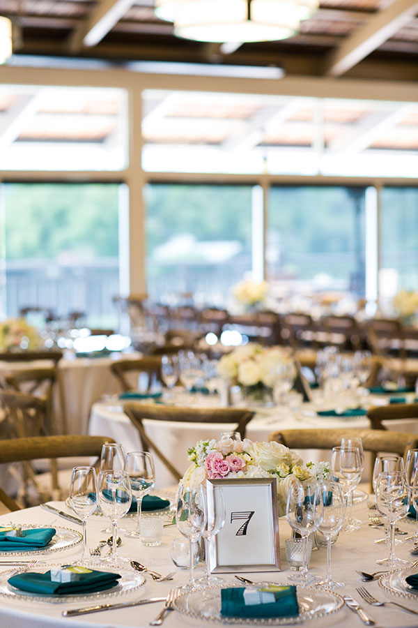 Wedding reception tables at a Carmel wedding at Quail Lodge by Destination wedding planner Mango Muse Events creator of Passport to Joy