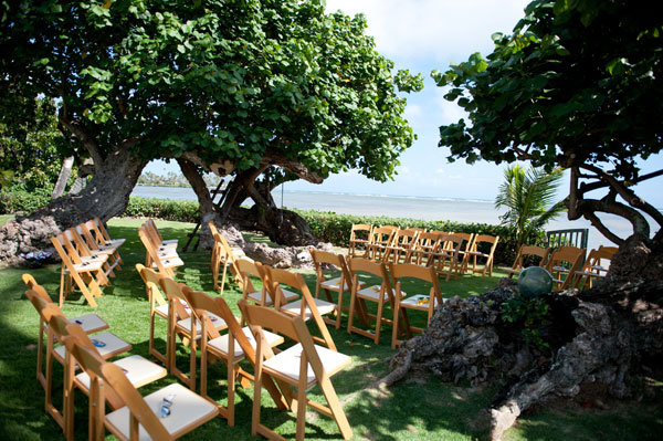 Intimate beachfront private estate wedding ceremony in Hawaii by Destination wedding planner Mango Muse Events creator of Passport to Joy
