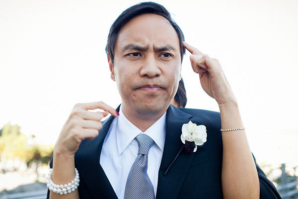 Groom making an unsure funny face at a wedding in San Francisco by Destination wedding planner, Mango Muse Events creator of Passport to Joy