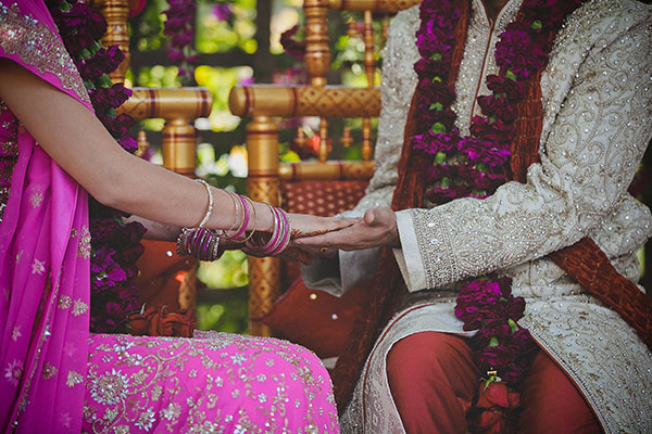 Bride and groom holding hands at their Hindu ceremony at a multi-cultural wedding by Destination wedding planner, Mango Muse Events creator of Passport to Joy
