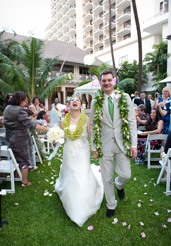 Bride and groom just married walking down the aisle at a destination wedding in Hawaii by Destination wedding planner Mango Muse Events creator of Passport to Joy