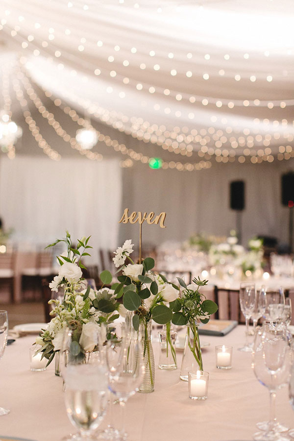 White wedding reception tent and string lights at a wine country wedding in Sonoma by Destination wedding planner Mango Muse Events creator of Passport to Joy