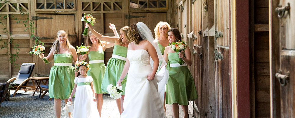 Bridal party celebrating at a wine country wedding by Destination wedding planner Mango Muse Events and creator of Passport to Joy the online wedding planning program