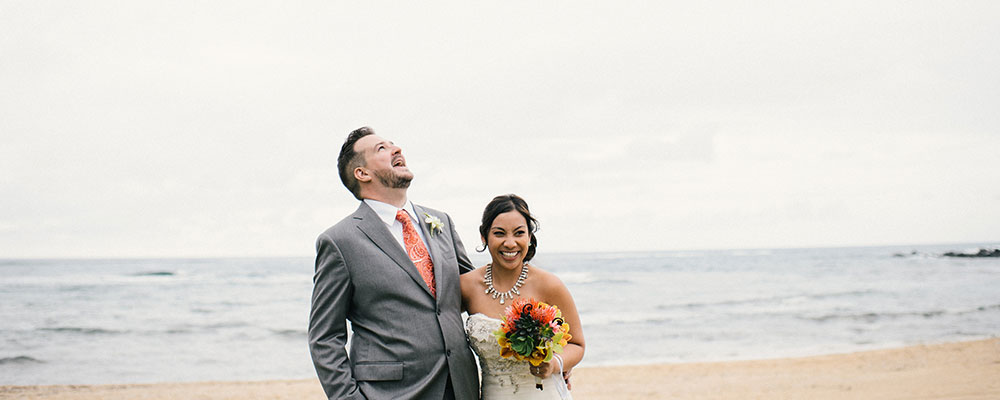 Happy couple at their beach wedding in Hawaii by Destination wedding planner Mango Muse Events creator of Passport to Joy the online wedding planning program