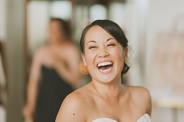 Happy bride laughing destination wedding in Hawaii by Destination wedding planner Mango Muse Events creator of Passport to Joy online wedding planning course