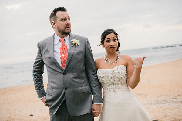 Bride and groom taking a silly fun photo at their Hawaii wedding by destination wedding planner Mango Muse Events and creator of Passport to Joy online wedding planning program