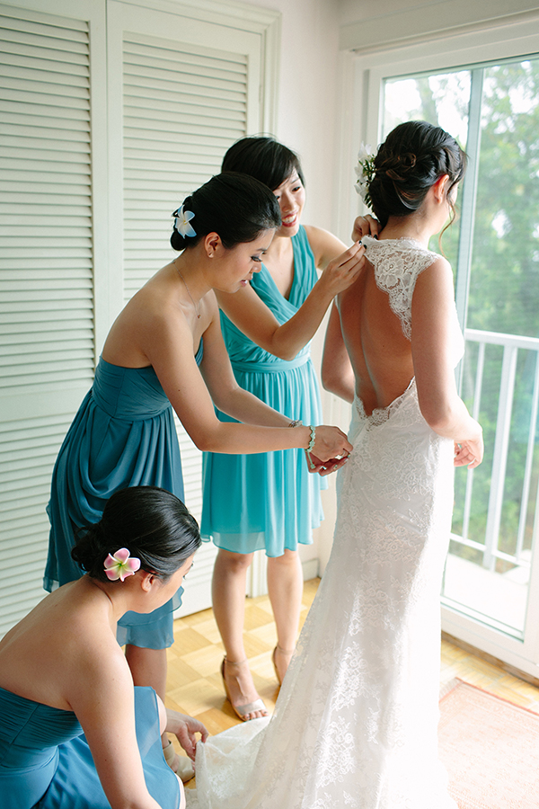 Bridesmaids helping a bride get ready on her wedding day from Mango Muse Events creator of Passport to Joy online wedding planning program.