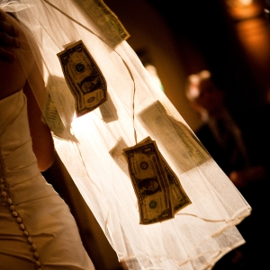 Bride with money pinned to her veil during the money dance at a Filipino wedding in San Francisco by destination wedding planner Mango Muse Events creator of Passport to Joy online wedding planning program