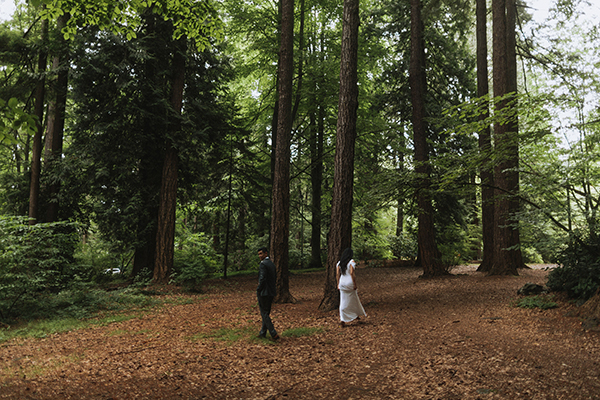 Bride and groom walking in the forest at Stanley Park in Vancouver by destination wedding planner Mango Muse Events creator of Passport to Joy online wedding planning course
