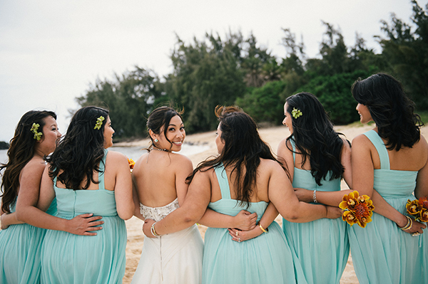 Bridesmaids supporting the bride at her beach wedding by destination wedding planner Mango Muse Events creator of Passport to Joy an online wedding planning program