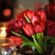 Red tulips and dahlia centerpiece at a fall Sonoma wedding by destination wedding planner, Mango Muse Events, creator of Passport to Joy online wedding planning course