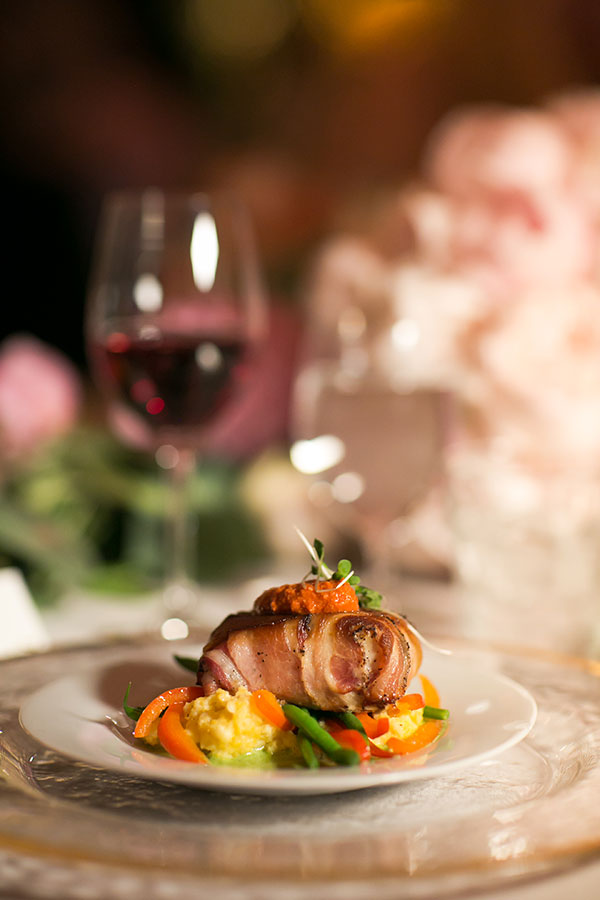 Panchetta wrapped sea bass plated meal for an elegant San Francisco wedding by destination wedding planner Mango Muse Events, creator of Passport to Joy