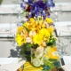 Yellow and purple floral centerpieces at a Hawaii wedding by destination wedding planner Mango Muse Events creator of Passport to Joy an online wedding planning course