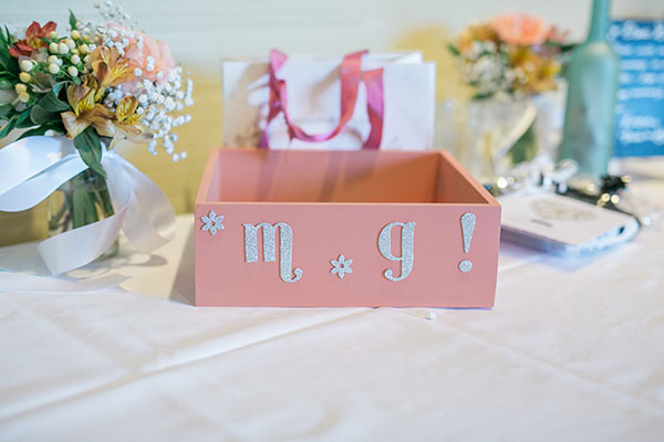 Peach wedding card box with couple's initials Passport to Joy online wedding planning program