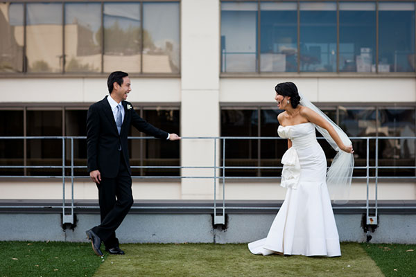 Bride and groom jokingly face off at a San Francisco wedding by destination wedding planner Mango Muse Events creator of Passport to Joy online wedding planning program for couples