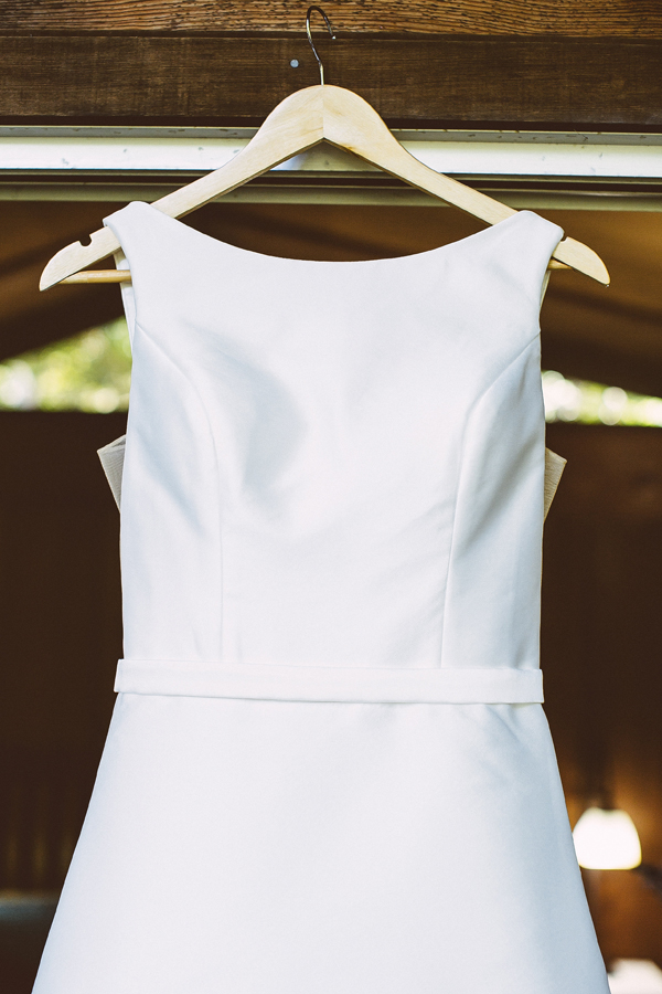 Classic boatneck white wedding dress for an elegant outdoor wedding by destination wedding planner Mango Muse Events creator of Passport to Joy the online wedding planning program for couples