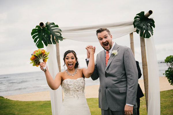 Happy couple just married at their wedding ceremony in Hawaii by destination wedding planner Mango Muse Events creator of Passport to Joy online wedding planning course for couples