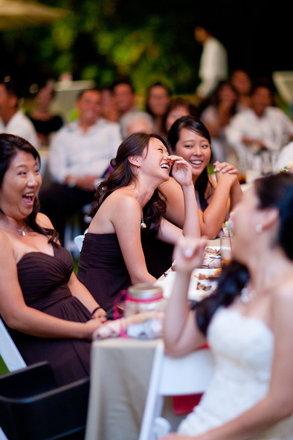 Bridesmaids laughing at a wedding reception in Hawaii by destination wedding planner Mango Muse Events creator of Passport to Joy the online wedding planning course for couples