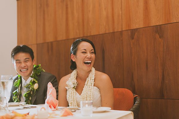 Happy couple laughing at their wedding reception toasts by destination wedding planner Mango Muse Events creator of Passport to Joy, the online wedding planning course for couples