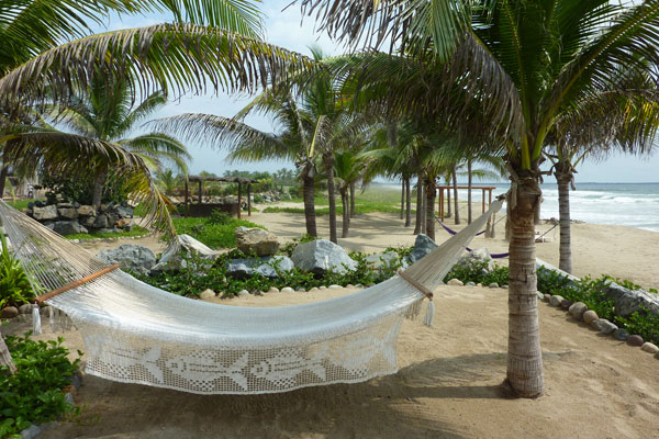 A hammock at a beach destination wedding in Mexico by destination wedding planner Mango Muse Events creator of Passport to Joy the online wedding planning program for couples