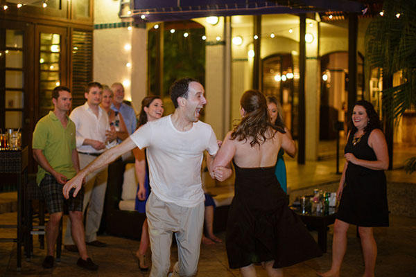 Happy guests dancing at a St. Croix destination wedding in the Caribbean by destination wedding planner Mango Muse Events creator of Passport to Joy the online wedding planning course for couples