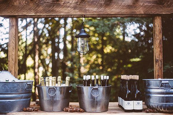 Self serve drinks at a wedding bar for a forest wedding Passport to Joy online wedding planning program