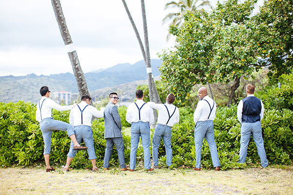 Groom and groomsmen taking a funny photo at a Hawaii destination wedding by destination wedding planner Mango Muse Events creator of Passport to Joy the step by step online wedding planning program