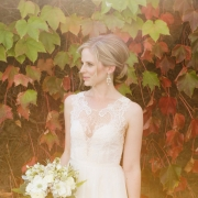 Beautiful bride at her fall wedding surrounded by fall leaves at a Sonoma destination wedding by destination wedding planner Mango Muse Events creator of Passport to Joy, the online wedding planning program for couples