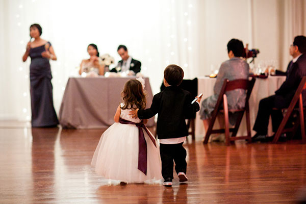 Ring bearer and flower girl listening to a wedding toast at a wedding reception by destination wedding planner Mango Muse Events creator of Passport to Joy the online wedding planning course for couples