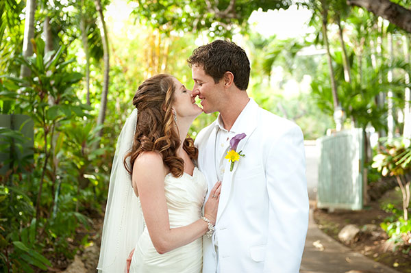 Happy couple almost kissing at a Hawaii destination wedding by destination wedding planner Mango Muse Events creator of Passport to Joy the online wedding planning program for couples