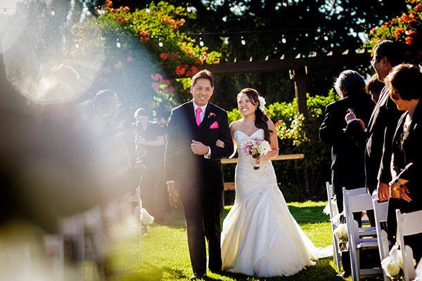 Bride and father of the bride walking in the wedding ceremony processional by destination wedding planner Mango Muse Events creator of Passport to Joy online wedding planning course for couples
